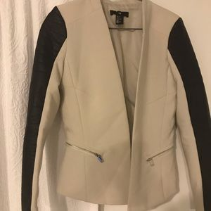 Off white coat with black leather-type sleeves